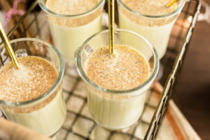 Traditional holiday drink egg nog garnished with nutmeg.